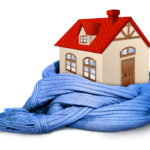single family home with red roof wrapped in a blue winter scarf, symbolizing keeping your house warm in winter