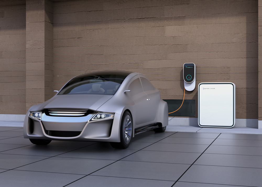 Silver electric vehicle charging in home garage, taking advantage off lower Off-Peak charging rates.
